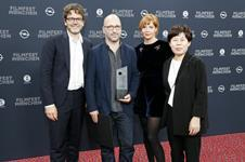 Producer Tiago Hespanha receives prize on behalf of Pedro Pinho from CineVision Award
