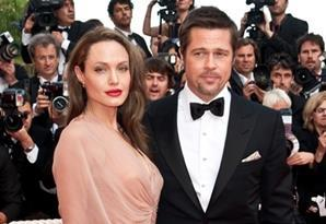 "(L-R) Actress Angelina Jolie and actor Brad Pitt arrive at the premiere of ""Inglorious Basterds"" at the 62nd Cannes Film Festival in Cannes."